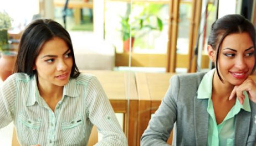 Two woman sitting at a table during a business meeting