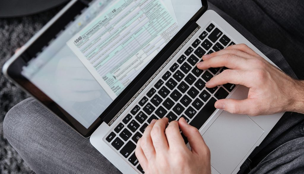 Man hands typing on laptop